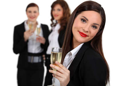 Business women drinking champagne photo