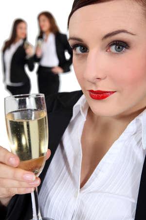 businesswoman drinking champagne photo