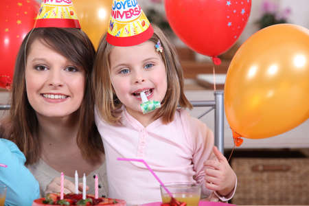 bash: Little girl with mother at party Stock Photo