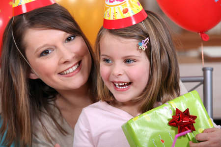 Little girl at birthday party photo