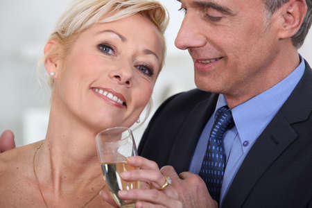 Mature couple drinking champagne photo