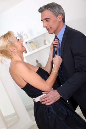 Woman adjusting husband's tie photo