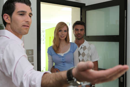 Couple looking at potential property photo