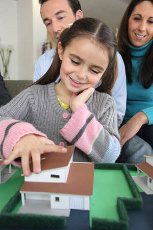 housing development: Young family with model housing Stock Photo