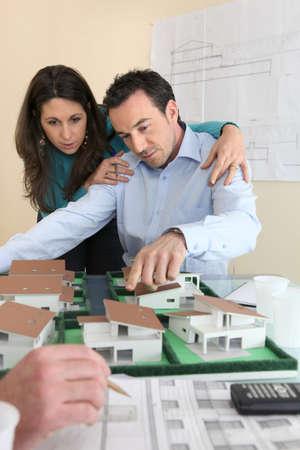 replica: Architects gathered around model replica of housing estate