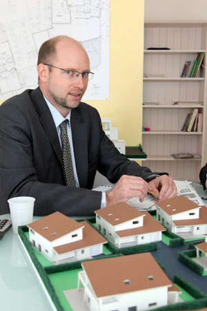 Architect with a model development photo