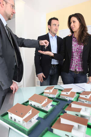 residents: Architect handing over the keys to a new property owner