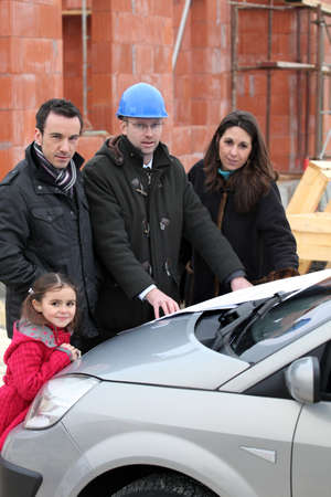 Architect at construction site with clients Stock Photo - 13962531