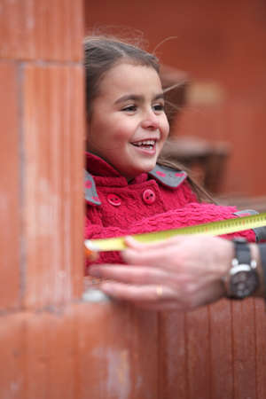 stonemasonry: Little girl on a building site