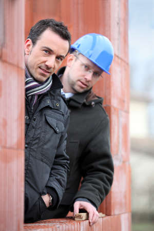 Two site workers hiding in unfinished house Stock Photo - 13959983