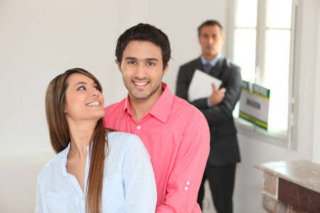 Young couple in their new house photo