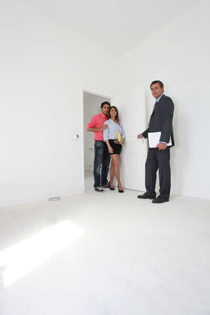 Estate agent with a young couple photo