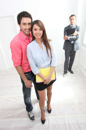 Couple being shown around property by estate agent photo