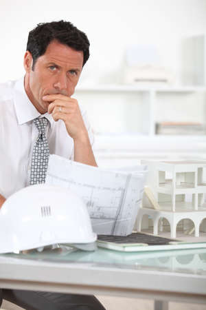 consternation: Architect with plans and 3D model Stock Photo
