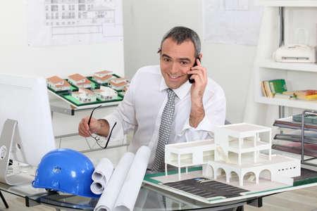 Architect on telephone call photo