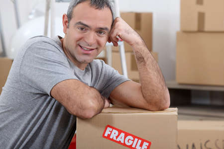 distributor: Warehouse manager stood by boxes