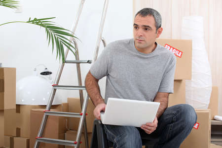 Man organizing logistics of house move photo