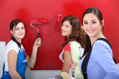 everyday people: Girls painting wall Stock Photo