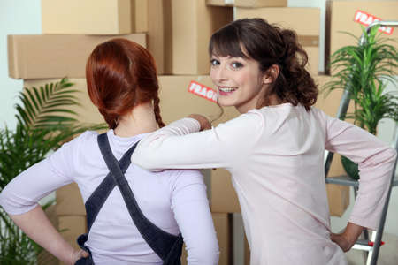Young women on moving day Stock Photo