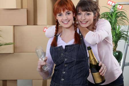 Two women celebrating house move photo