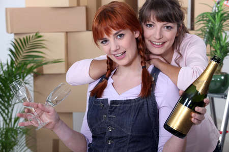 duo: duo of female flatmates celebrating removal