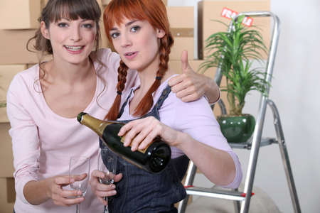 Young women celebrating on moving day photo