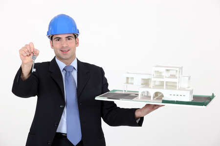 procurement: Architect with keys to a new build