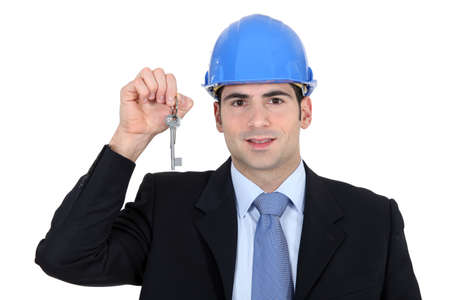Engineer holding up a key photo