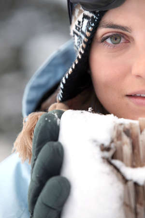 Head-shot of woman in the snow photo