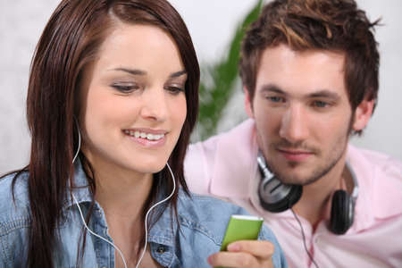 Couple listening to music Stock Photo - 13941456