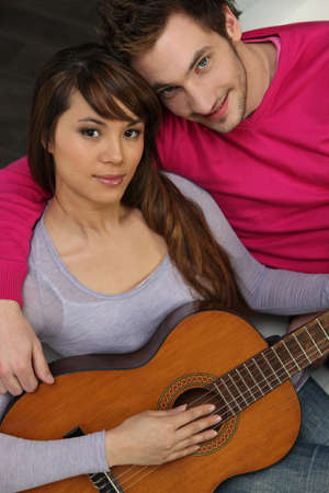 the sincerity: Couple sat with acoustic guitar