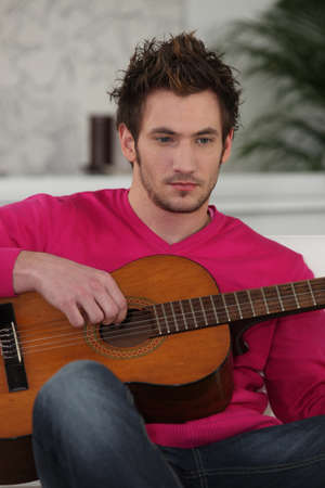 young with Spanish guitar photo