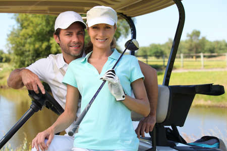 Couple in golf car photo