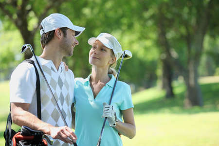 woman golf: portrait of a couple in golf clothes Stock Photo
