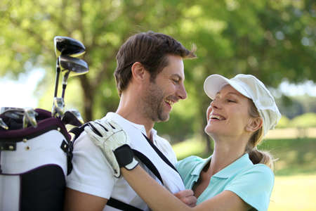 arms around: Couple embracing on the golf course