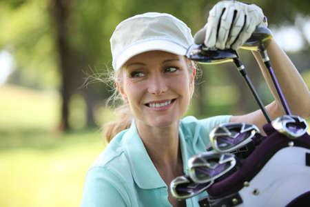 golf glove: Woman on golf course Stock Photo