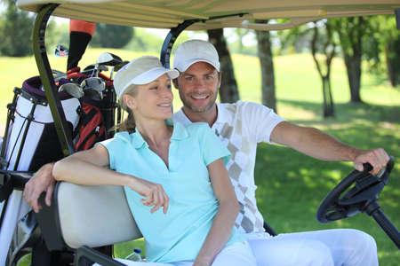 Couple playing golf photo