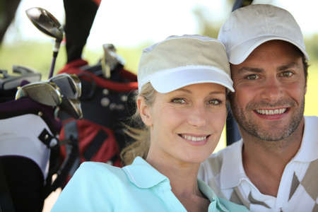 woman golf: Couple playing a round of golf