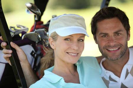 Couple in golf sportswear photo