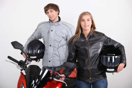 Couple stood with motorbike photo