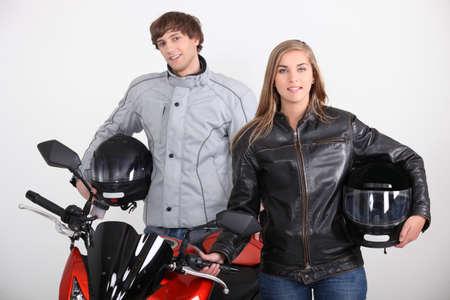 Couple stood with motorbike photo