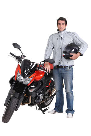 safety gear: Motorcyclist with his motorbike Stock Photo