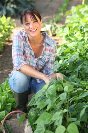 mature brunette: Woman in garden Stock Photo