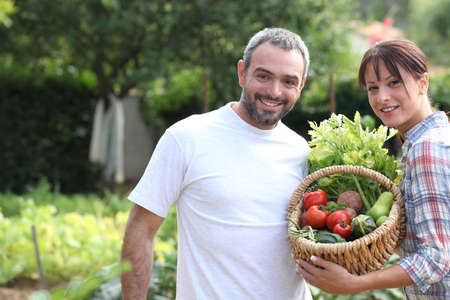 peasant: A couple taking care of their vegetable garden.