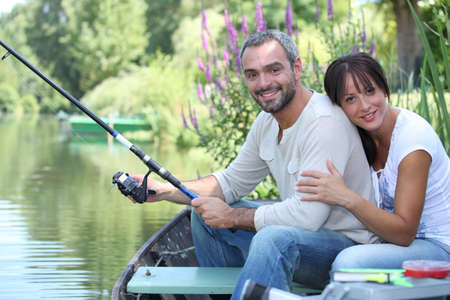 so: Couple sitting in a boat fishing