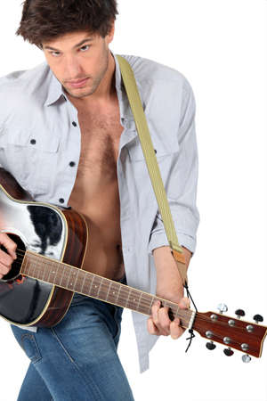 Man playing the guitar on white background photo