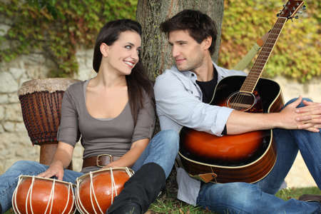 couple playing music in the park photo
