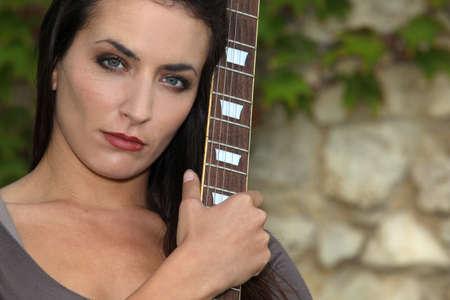 beautiful brunette with bass photo