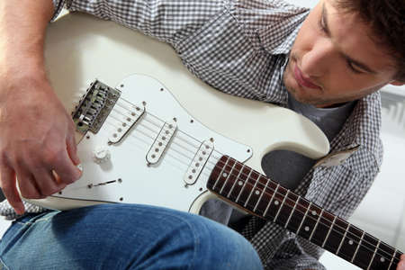 Young man with an electric guitar photo
