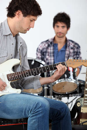 young men playing music photo